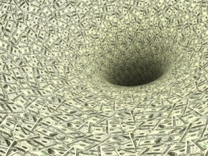 Money spiraling down a black hole, symbolising waste