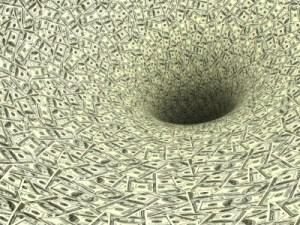 Money spiraling down a black hole, symbolising waste