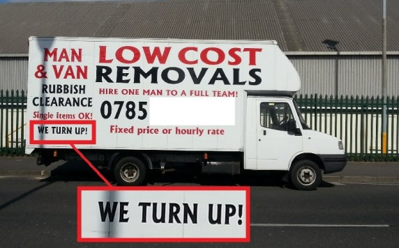 "Van with the words ""We Show Up"" on the side, amongst other signwriting"