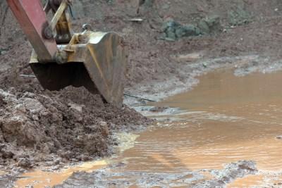 Excavator digging mud