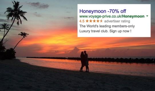 couple on a beach as the sun sets