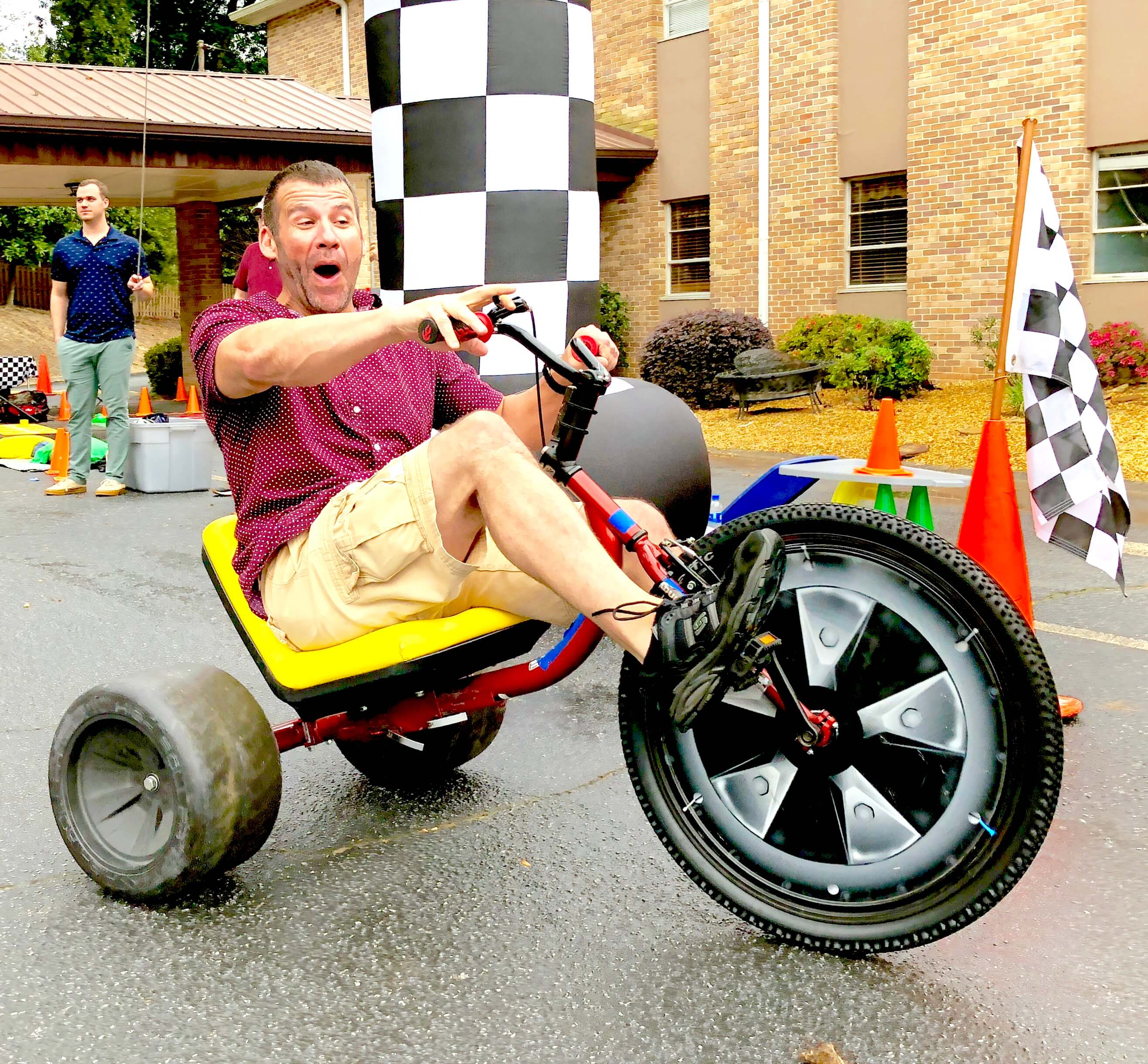 This guy is super excited for his first ride at an Adult Big Wheel Club team building event