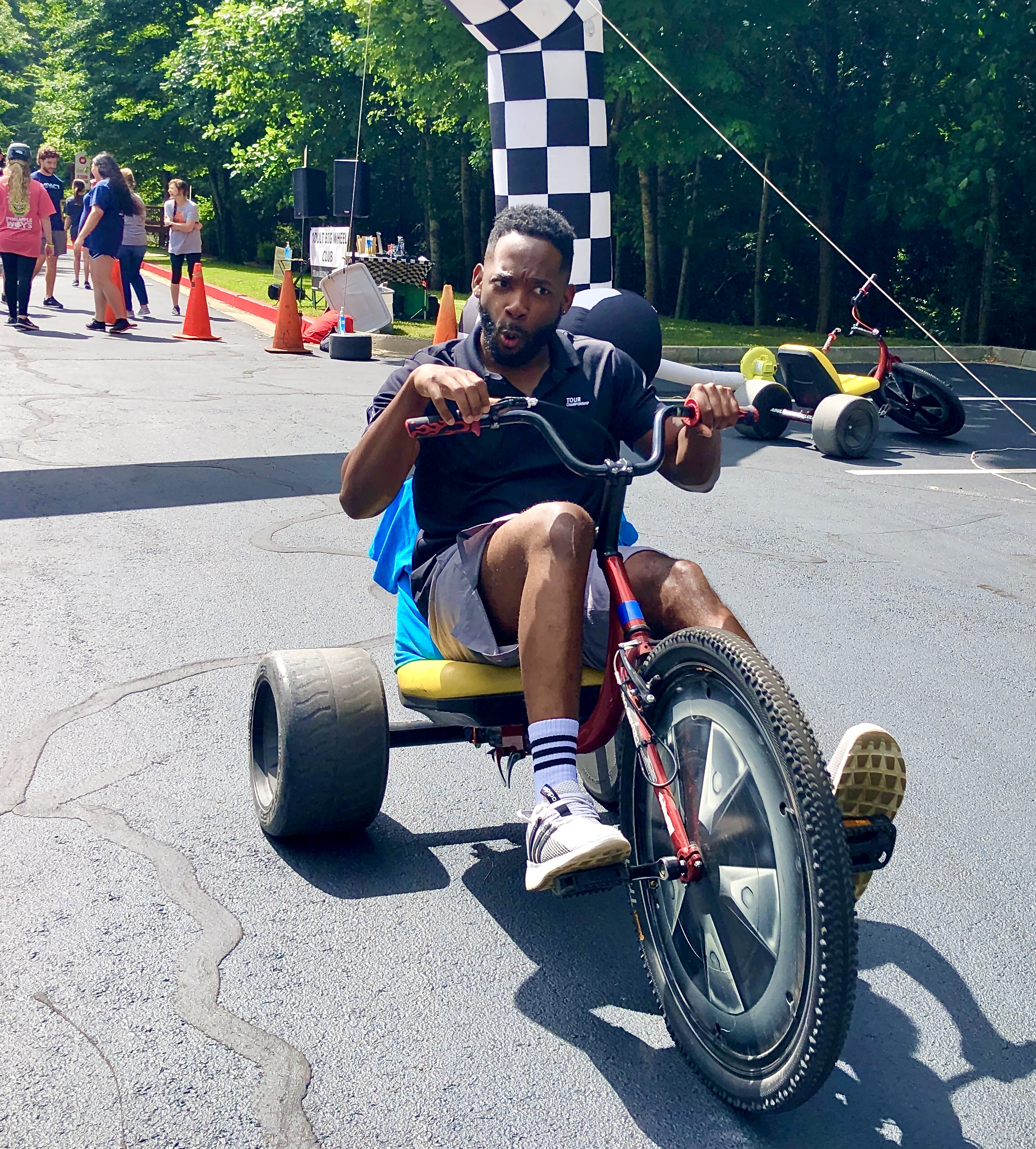 First time on a Big Wheel ? that's the face I made too , happy guy on his first adult big wheel club team building event