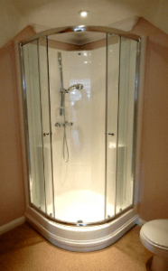 Round shower with glass doors