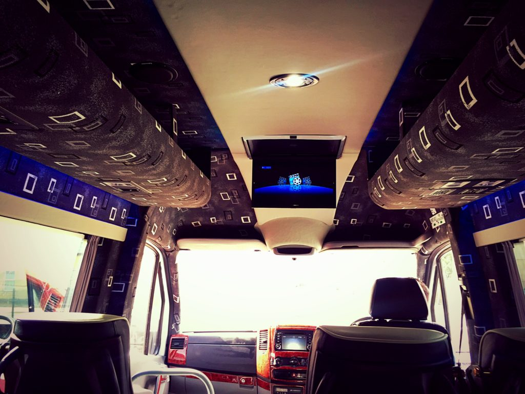 View of DVD player from inside the luxury 2009 Mercedes Sprinter Minibus Hire