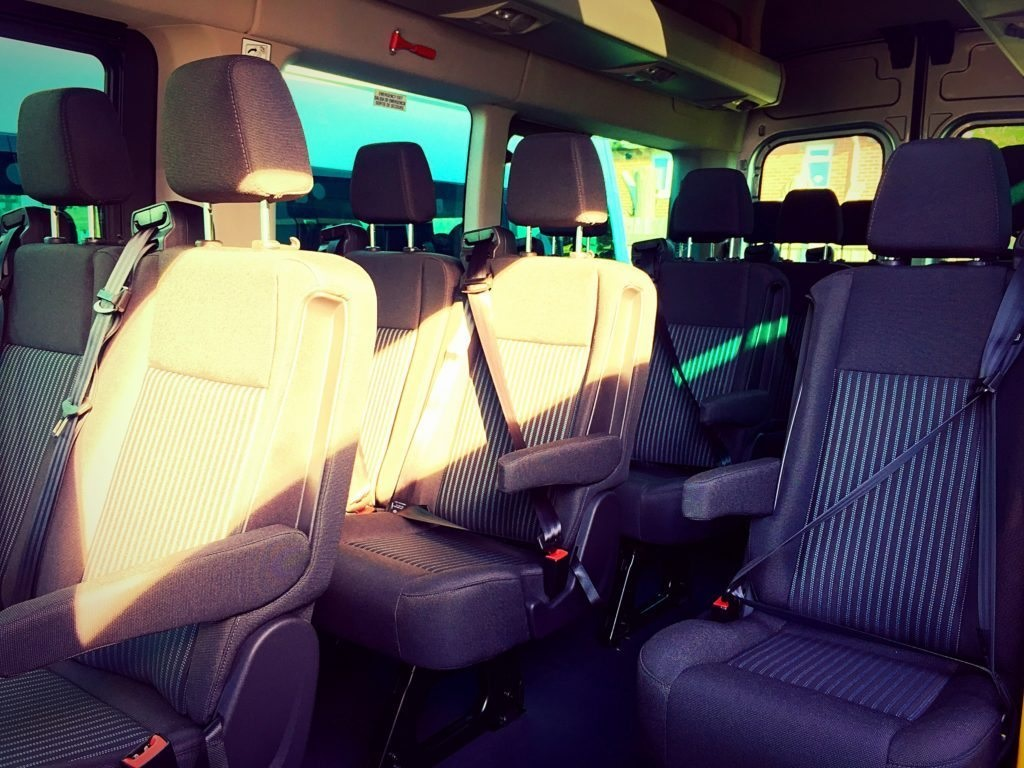 The seats in our 16 Seater Ford Transit minibus. Featuring three-point seatbelts, headrests, arm-rests and air conditioning.