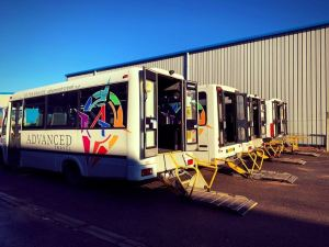Picture of wheelchair accessible minibuses with tail lifts extended