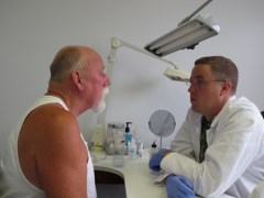 Ocularist with artificial eye patient2