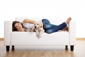 save on upholstery cleaning Santa Rosa - woman and dog on couch