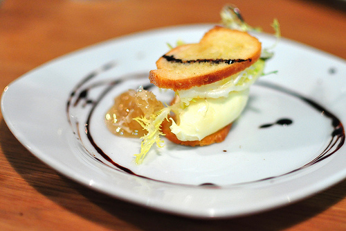 Brie chantilly napoleon with honeycomb, aged balsamic vinegar and frisee