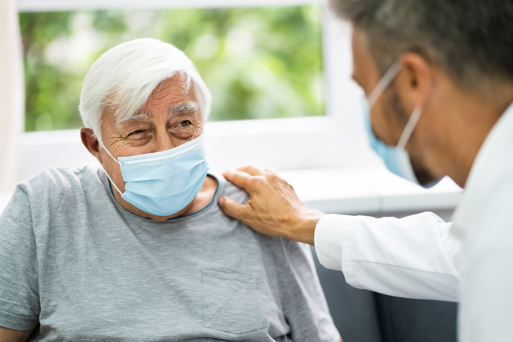 older patient speaking with physician