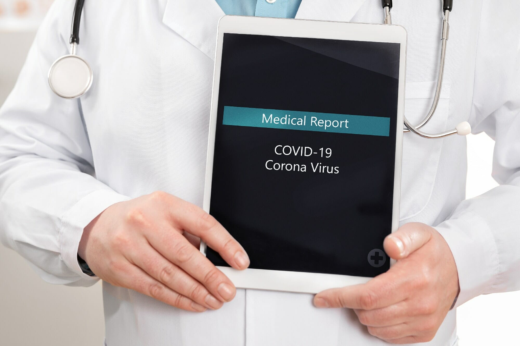 Close-up of male doctor showing medical covid-19 corona virus report on a tablet