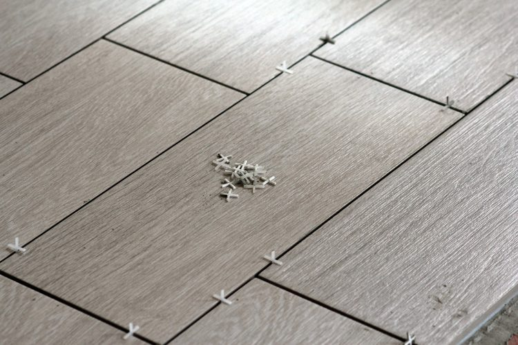 why should you hire a professional tile installation company advantix systems