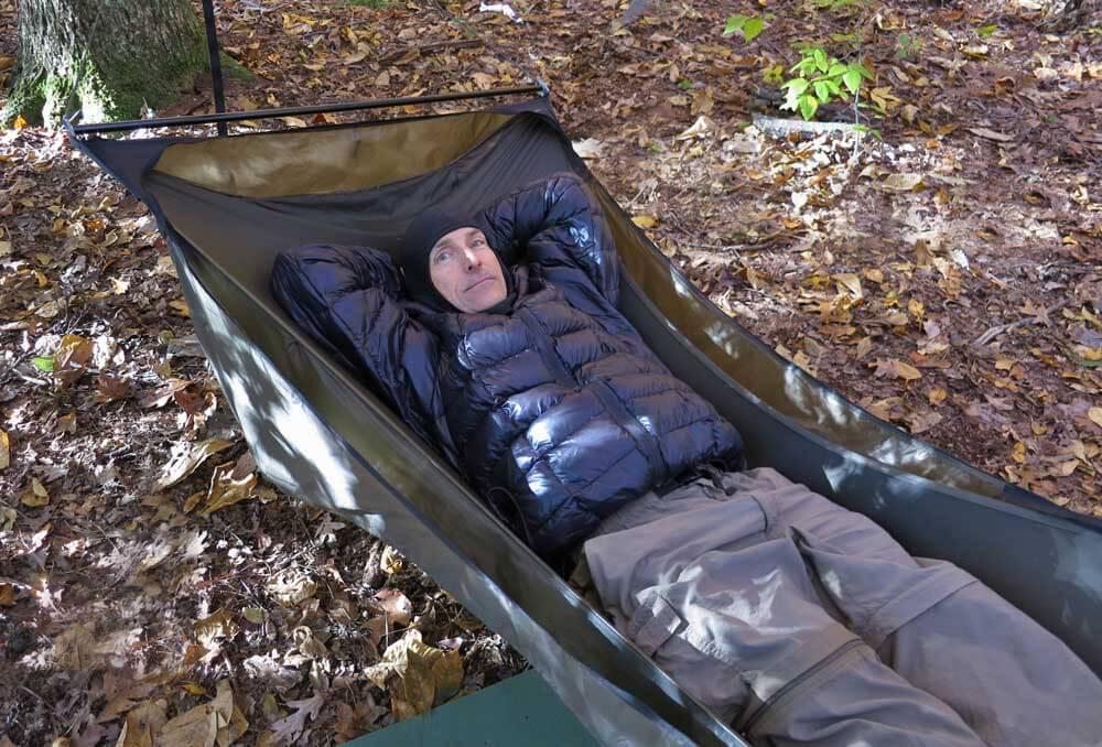 Due to spreader bar width, bridge hammocks may require a wider tarp than gathered end hammocks. (Pictured Warbonnet Ridge Runner hammock)