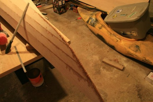 Building a wooden kayak: Filling in the seams.