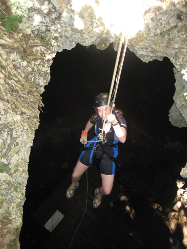 Rappelling into a cenote.