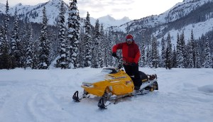 K taking the snowmobile for a test drive