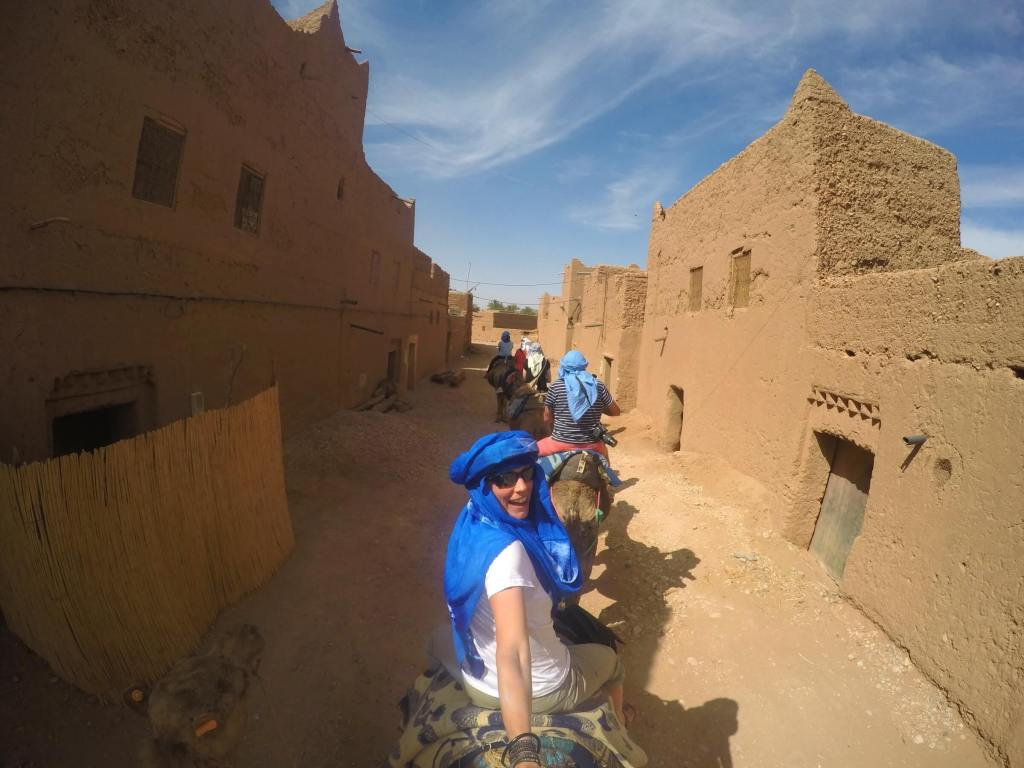 Riding our camels through town.