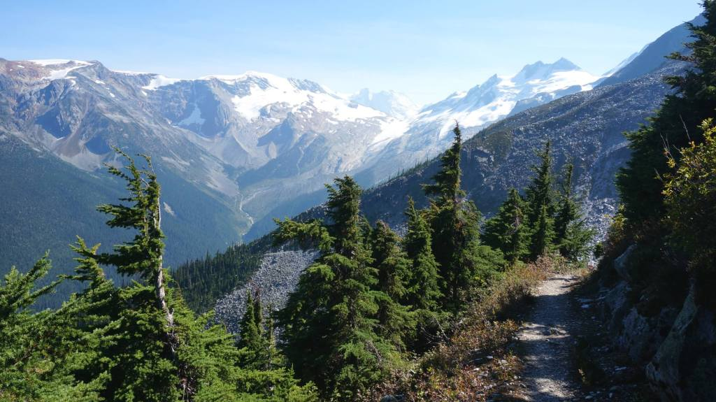 Hiking on the easy but long route with views of the Asulkan Glacier. The trail veers right and crosses a large rock slide