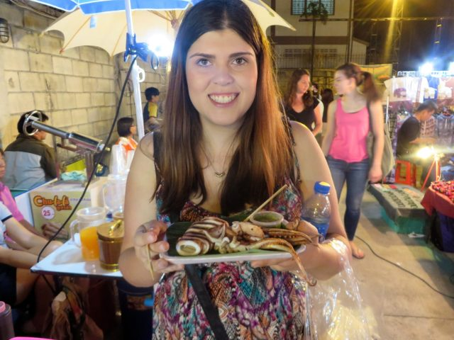 I'm stoked with my plate of squid at the Saturday night walking market in Chiang Mai