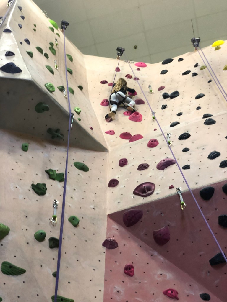 girl rock climbing indoor