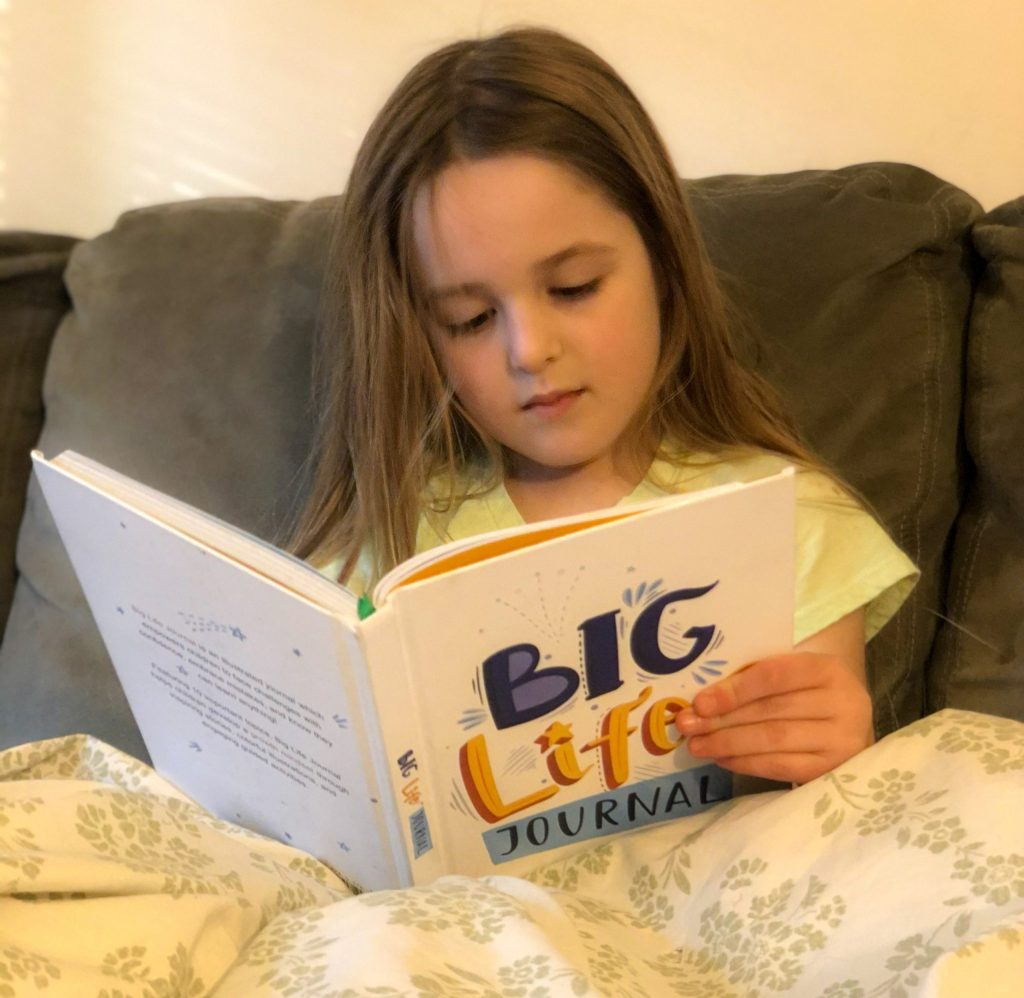 girl reading Big Life Journal 2