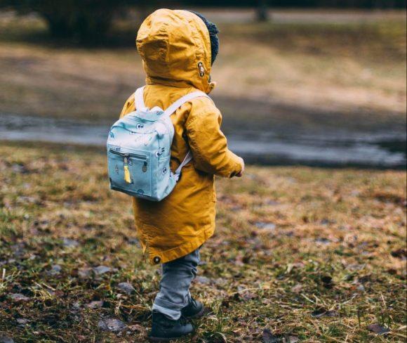 kid wearing back pack