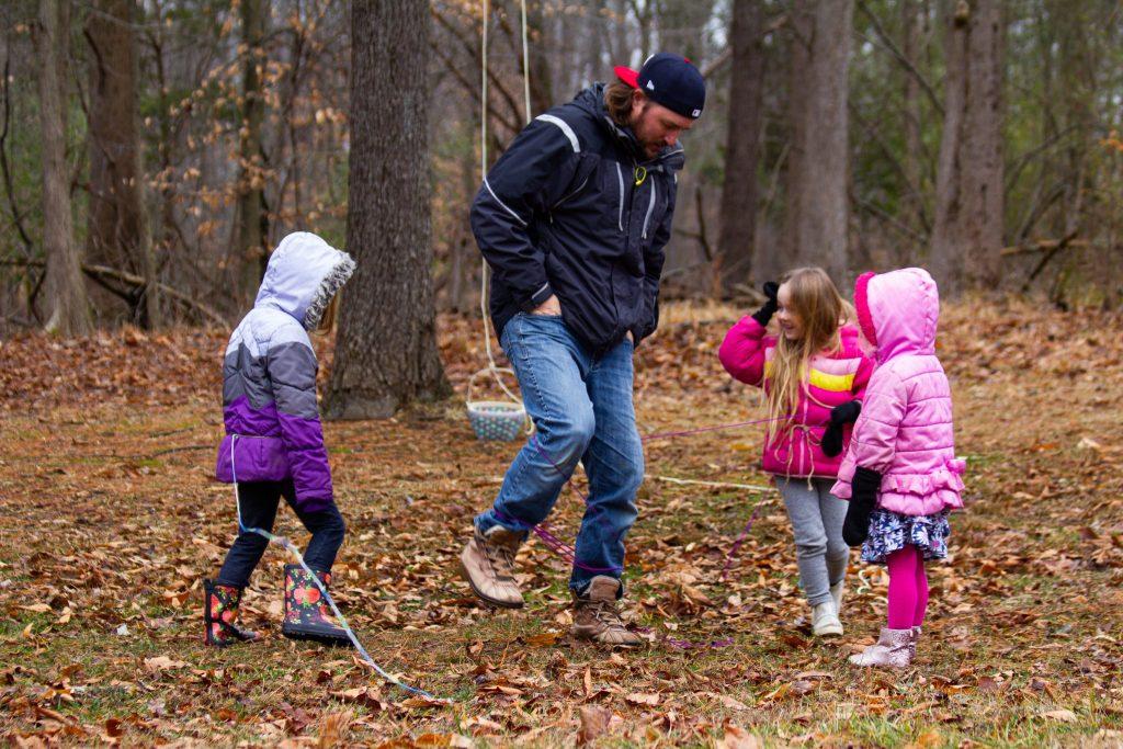 family playing at Tinkergarten