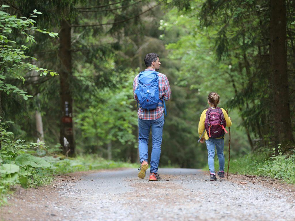 kid hiking with parent