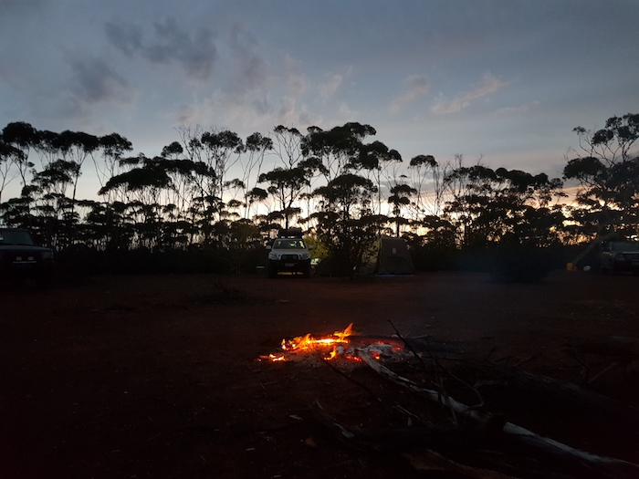 A good campfire on the first night on the Holland Track resisted the blitzkrieg storm that hit us twice..