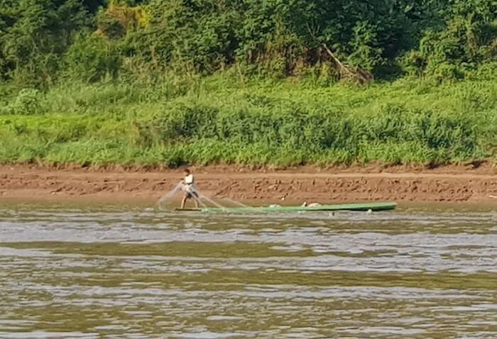Fisherman. With somewhere between 770 and 1200 species, the Mekong has a very high fish biodiversity.