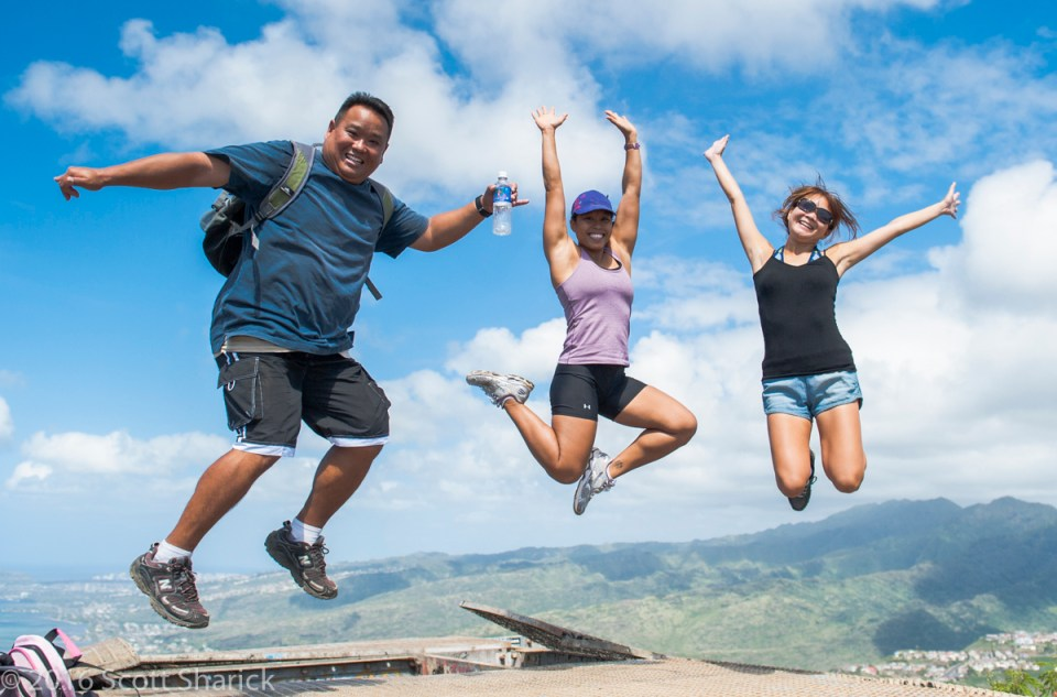After a strenuous hike up Koko Crater Ryan, Leslie, And Shelley still have more than enough energy to get airborne.