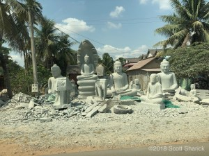 Many roadside stone carving business line both sides of the road near Kampong Thma on National Road 6 in Cambodia.