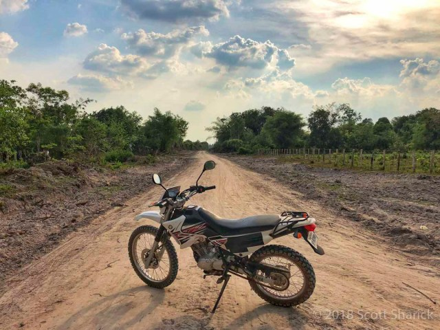 My motorcycle along the 'new' road to Banteay Ampil