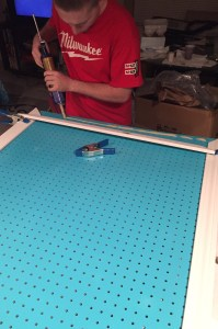adding border to the pegboard- DIY craft pegboard is a perfect way to organize all your items in your craft room while maximizing your space.
