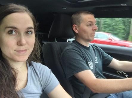 Couple enjoying a car ride while exploring Raleigh, NC.