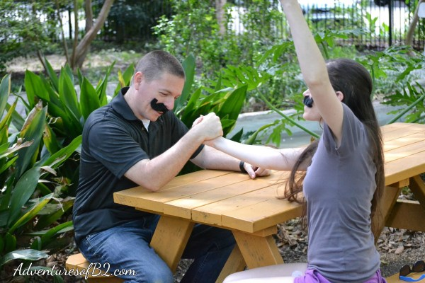 Arm Wrestle Win: Fantastic engagement photo idea for any fun couple or married couple to enjoy! Get creative fun couple photo ideas for a fun couple photoshoot.