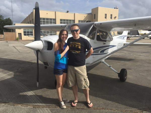 couple at lakefront airport with private plane in new orleans aerial tour