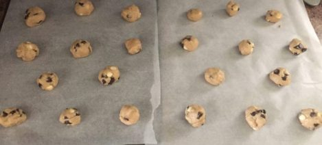 Triple chocolate chip cookie dough rolled into a ball and ready to be baked. Perfect snack with all the chocolates.