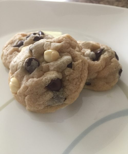 the triple chocolate chip cookies sitting on a plate ready to be gobbled up! These super soft cookies are a combination of milk, white and dark chocolate to give the best flavors a cookie can handle.