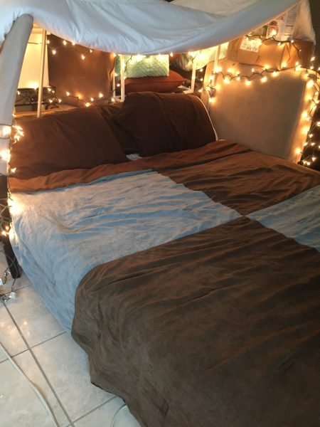 Spice up date night with this creative at home date idea! Go on a mini getaway at home with your spouse to break away from the norm and spend quality time together.