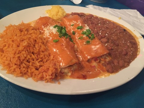 One of the tasty chicken enchiladas dinner plate at Chevy's mexican restaurant in portland oregon. A delicious restaurant for your mexican food cravings.