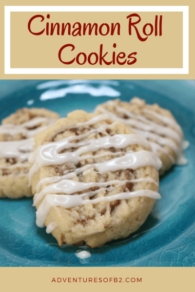 Cinnamon Roll Cookies - These cookies are your favorite breakfast in a dessert. Soft buttery sugar cookie with cinnamon sugar filling drizzled with icing. So delicious, you can't just have one! - AdventuresofB2