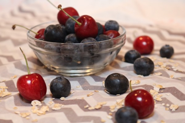 mixed berry fruit with a bowl full of fresh blueberries and cherries