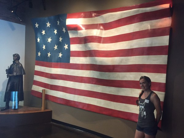 inside the Fort McHenry museum, you can see the American flag with 15 stars and 15 stripes in Baltimore Maryland