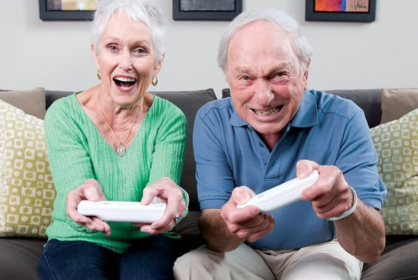 couple playing wii making it quite a competition. A fantastic at home date idea.