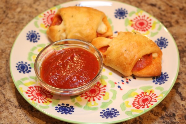 These pizza pockets are so delicious. The soft dough of the crescent rolls paired with cheese and pepperoni cooked to perfection. Add a side of marinara for dipping!