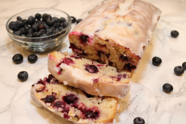 A tasty loaf of bread bursting with lemon and blueberry flavors. This lemon blueberry bread topped with a lemon glaze is a bright flavorful bread that makes a perfect gift or dessert.