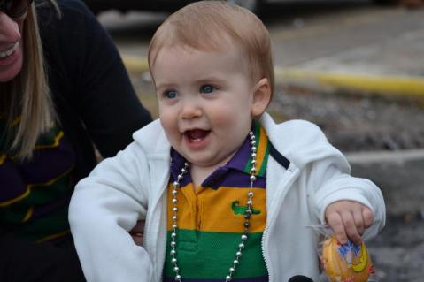 Just a baby with her moon pie! Can you sense the excitement of enjoying her first mardi gras?! Learn all the best tips for surviving Mardi Gras in New Orleans with an infant here at adventuresofb2.com