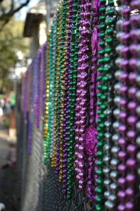 At any given time in the year, walking down the streets of New Orleans, you may see beads hanging on a fence. Just another unique thing we love to do here. Coming to Mardi Gras for the first time? Learn what to expect at your Mardi Gras in New Orleans at Adventuresofb2.com